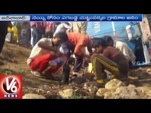 Ghee Tanker Overturns On National Highway In Adilabad | Locals Rush To Collect Ghee | V6 News