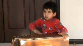 Kid Playing Harmonium