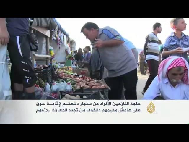 سوق داخل مخيم لنازحي سنجار