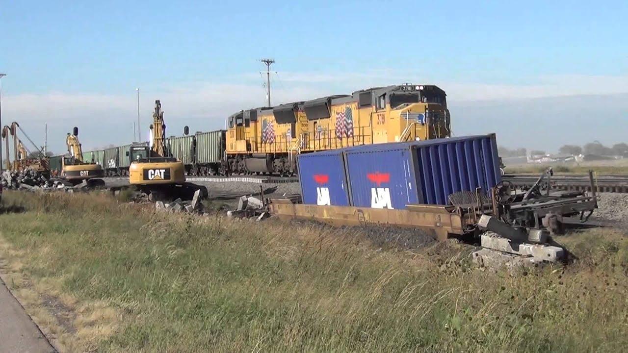 union pacific  5731 ballast train passes derailed apl container car   central city  ne 9  23  13