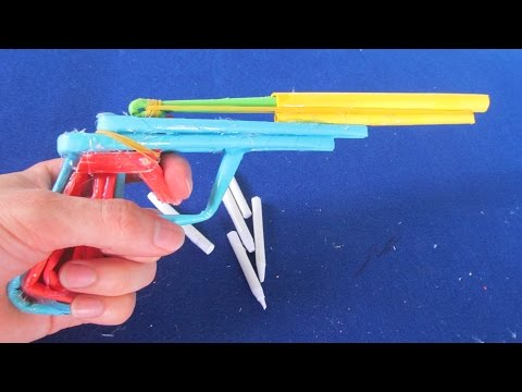 Как сделать пистолет из бумаги видео который стреляет резинками