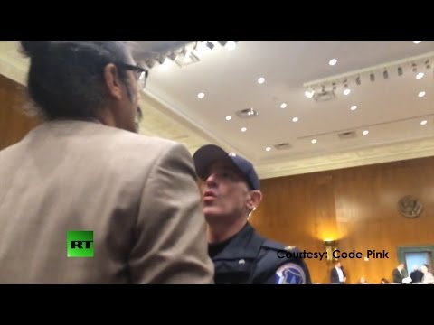 Courtesy: Code Pink Capitol police arrested lawyer and activist Shahid Buttar after a Senate hearing featuring Director of National Intelligence James Clapper had ended, stopping him from...