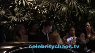 Actor Tom Hiddleston chatting with women while waiting at the valet