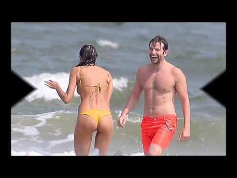 Irina Shayk stuns in mustard bikini as she hits the beach with boyfriend Bradley Cooper thumbnail