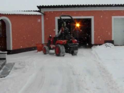 Kubota bx2350 plowing snow