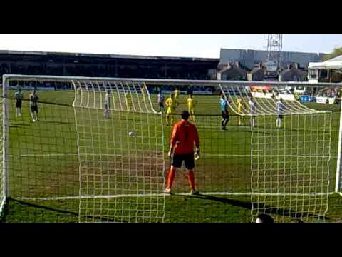 Nicky Wroe scores a penalty for Torquay United in front of their own fans, the first of 3 goals as Torquay United beat Grimsby Town 3-0 away from home. Torquay fans celebrate and sing 'We are...
