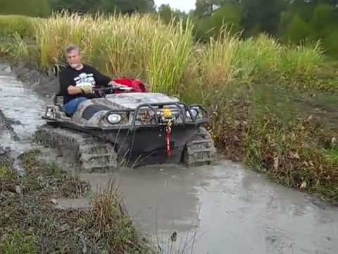 This is My Argo 650 HD with Adair tracks in a bad mud hole ...