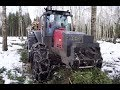 Valtra 6850 forestry tractor in winter forest