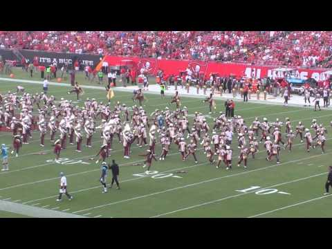 During halftime at the bucs game #9 Graham Gano shoves band members during their routine.