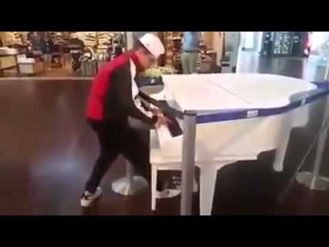 Kid surprises and amazes on public piano