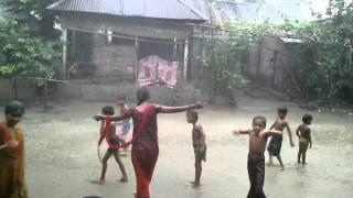 Bangladesh Village kids playing in the rain