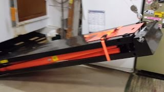 Hoisting Motorcycle Lift Table Against Wall via Electric Winch