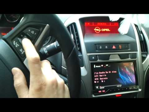 Opel Astra J radio doble din conservando controles originales