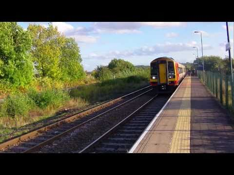 Trial upload from HD camera. No tripod. Northern Trains departure to Nottingham and EMT departure to Liverpool, from Langley Mill, Derbyshire. Best viewed at 1080p.