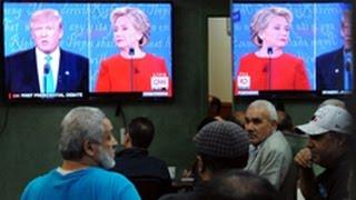 Trump, Clinton to woo votes in same Iowa city