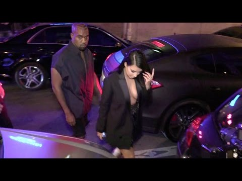 Lucky Kanye West, Kim Kardashian and her massive cleavage on a romantic date Paris.