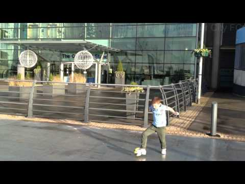 7 year old practises his soccer skills outside the football stadiums of Barcelona, Manchester United, Liverpool, Manchester City, Everton, Wigan Athletic, Blackpool, Blackburn Rovers, Bolton...