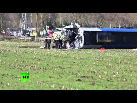 Passenger train hits crane, derails in Netherlands