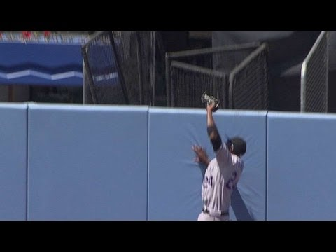 Fowler leaps for catch at the outfield wall