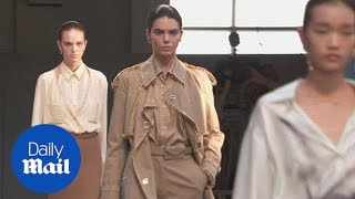 Kendall Jenner stuns in Burberry trench coat lined with gold hoops