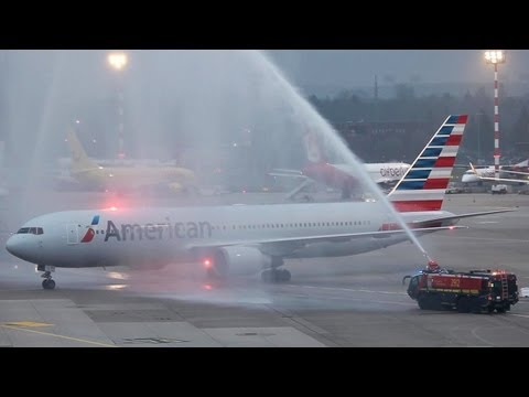 First American Airlines Boeing 767 Flight to Düsseldorf. Double Water Canon Salute (HD)