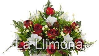Arreglos florales artificiales. Jardinera cerámica rosas artificiales rojas y liliums- La Llimona