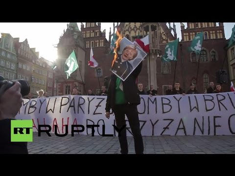Poland: Merkel picture burns as right-wingers protest EU refugee policy