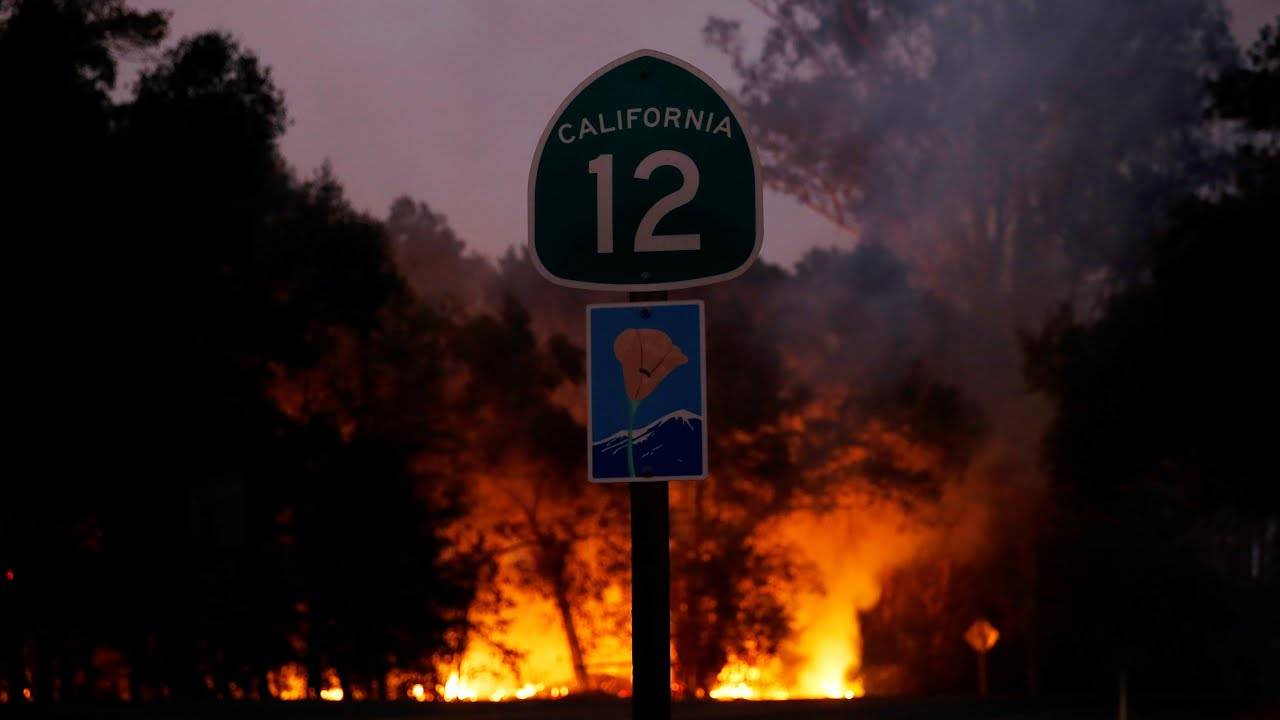 Family film their escape from California wildfire: 'even the road is alight'
