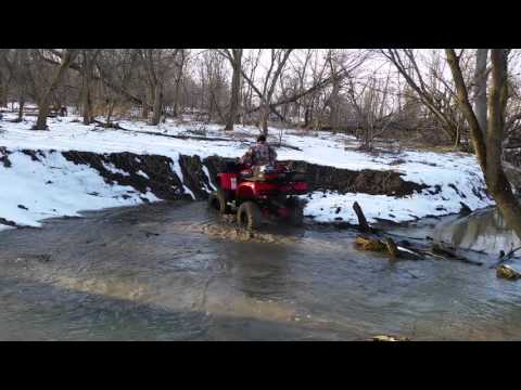 Lifted arctic cat 700 deep water crossing atv off road