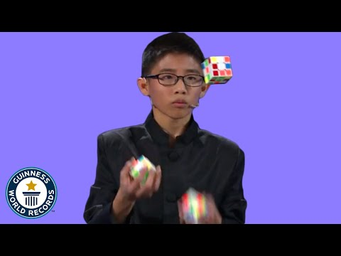 Play this video He JUGGLED and SOLVED 3 Rubik39s cubes! - Guinness World Records