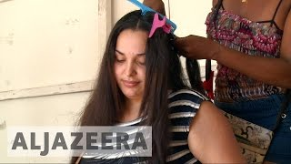 Venezuelan women sell hair to buy food