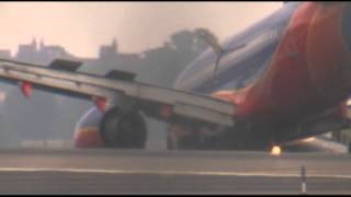 Raw: Plane's Nose Gear Collapses in NYC Landing 7/23/13