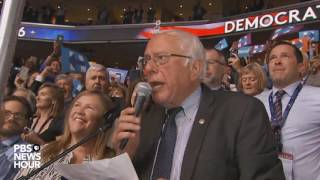Bernie Sanders surprises crowd, moves to nominate Clinton by voice vote at the 2016 DNC
