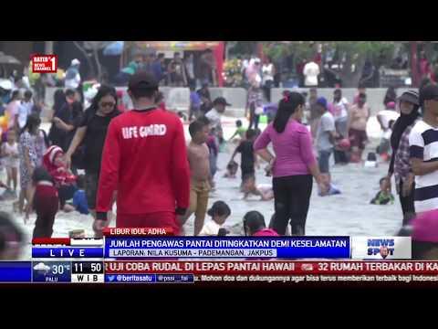 Keseruan Warga Berlibur di Pantai Ancol Saat Libur Idul Adha