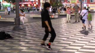 Contact juggling and brake dance street performer