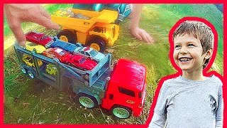 Toy Cars and Trucks on a Dirt Mound