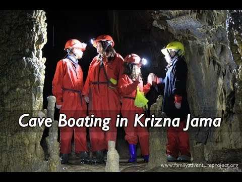 Exploring Krizna Jama Caves by boat, in Slovenia's karst region