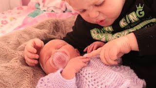 Big brother meets baby sister for the first time