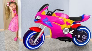 Sasha Rides on Toy Sportbike with Surprise Eggs & play with Toys