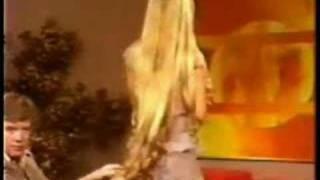 Debra Jo Fondren's knee length long blonde hair is admired