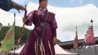 Jumong shooting arrows behind his brothers.