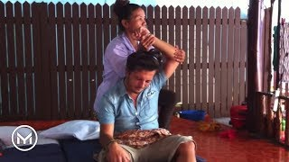 Youri's first and last thai massage (on the beach in Thailand)