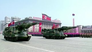 North Korea parades new missiles