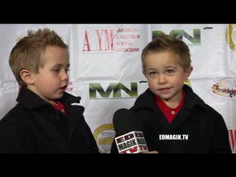 Jason Martin, ED MAGIK TV Host Reporter, interviews child actor twins Morgan and Frank Gingerich at ASYM's Holiday Toy Drive Fundraising Extravaganza at Cele...