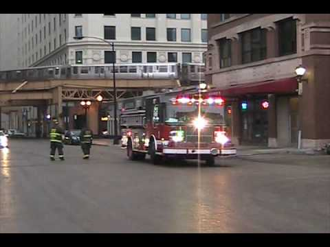 Chicago Fire Department: Engine 1 Returning to Quarters with L Trains Passing Overhead Video