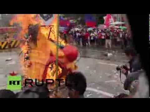 Philippines: Protesters burn Benigno Aquino III effigy, get hit by water cannons