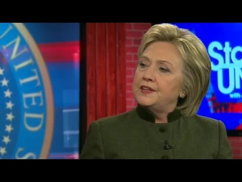 Clinton rejects Warren's charge that Wall Street mon...
