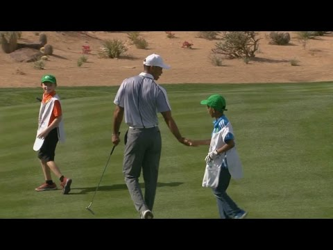 Tiger Woods' littlest fans help him putt on hole No. 16 at TPC Scottsdale