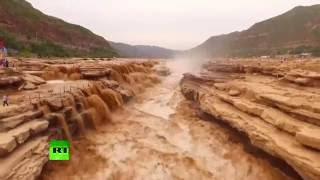 Mesmerizing force of nature: Chinese waterfall in spectacular rage after rainfall (Aerial footage)