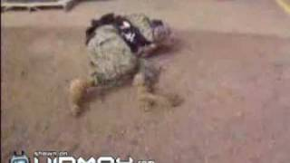 US soldiers gets blasted by a paintball machine gun